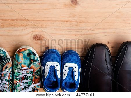 Shoes For The Entire Family On Wooden Floor