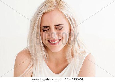 Beautiful woman laughing grudgingly close-up Funny joke, humor. Human facial expression emotions, feelings, body language