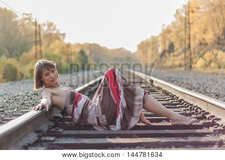 Beautiful Girl Laying On Railroad Track.