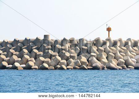 Concrete tetrapods make up a breakwater in Jeju Island South Korea.