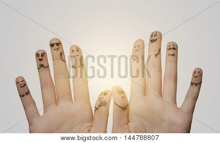 gesture, family, wedding, people and body parts concept - close up of two hands showing fingers with smiley faces
