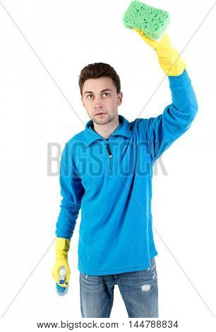 front view of a houseowner in gloves with sponge and detergent. man watching. curly-haired man in a blue warm jacket dull washes a window.