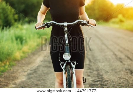 Detail Of A Bicycle. Woman Riding Her Bicycle. Bicycle  On Road