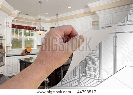 Male Hand Turning Page of Custom Kitchen Photograph to Drawing Underneath. Property release attached is for the DATE the kitchen was photographed NOT the photograph of the hand flipping of the page.