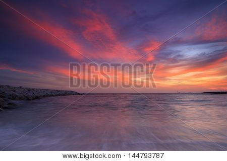 the beautiful burst sunset over sea in Thailand
