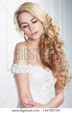 Young cute blond Bride. Hairstyle gentle portrait.