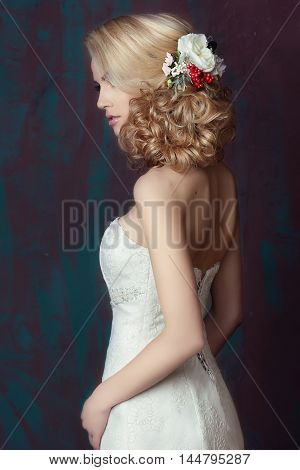 Beautiful young cute bride. Wedding festive hairstyle