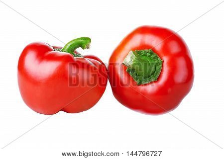 Two red peppers on a white background