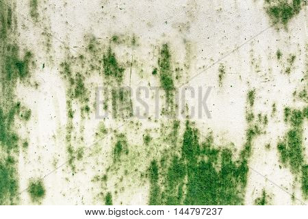 Abstract background on green metal plate with peeling plaster.