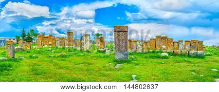 Panorama of Noratus Cemetery with many preserved khachkars covered with complex carved patterns Gegharkunik Province Armenia.