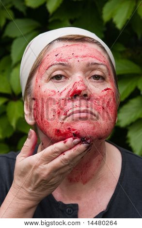 Woman Puts A Mask On The Face