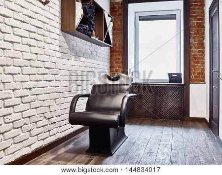 Chair for washing hair at the Barber shop. Interior.
