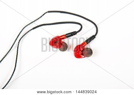 Sporting earphones for sport trainings with fixing behind an ear