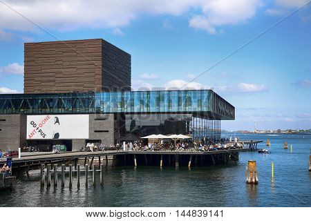 COPENHAGEN DENMARK - AUGUST 15 2016: The Royal Danish Playhouse (Skuespilhuset) is a National Theater on the harbour building designed by Lundgaard Tranberg in Copenhagen Denmark on August 15 2016.