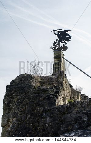 Old wind vane as an angel with the sword
