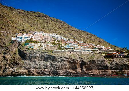 beautiful view ot the village Los Gigantes from the ocean Tenerife Spain