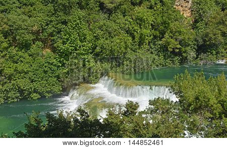 Skradinski Buk waterfall on the River Krka in Krka National Park Sibenik-Knin County Croatia. The waterfall consists of travertine barriers and a total of 17 different water falls it is considered to be one of the most beautiful calcium carbonate waterfal