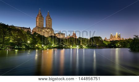 Central Park by The Lake at twilight with illuminated pathway and gazebos. Upper West Side, Manhattan, New York CIty