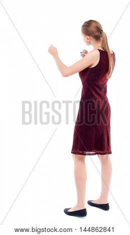 skinny woman funny fights waving his arms and legs. A girl in a burgundy dress sleeveless boxing.