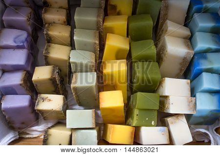 Columns and rows of various colorful homemade bar soaps
