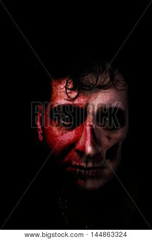 Living dead zombie monster portrait with skull showing