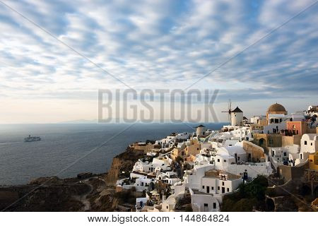 Santorini is one of the Cyclades islands in the Aegean Sea. It was devastated by a volcanic eruption in the 16th century BC, forever shaping its rugged landscape. The whitewashed, cubiform houses of its 2 principal towns, Fira and Oia, cling to cliffs abo
