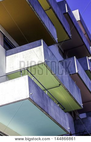 Brightly colored balconies as seen from below.