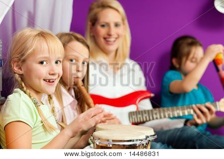Family - Children and mother - making music; they are practicing playing guitar, bongo and flute poster