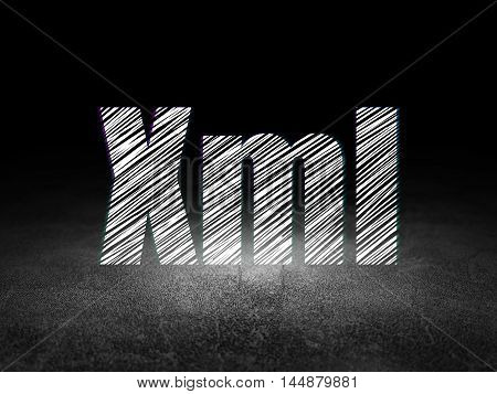 Programming concept: Glowing text Xml in grunge dark room with Dirty Floor, black background
