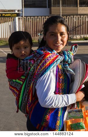 Peruvian People, Mother And Baby