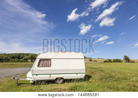 A Small caravan on a camping site