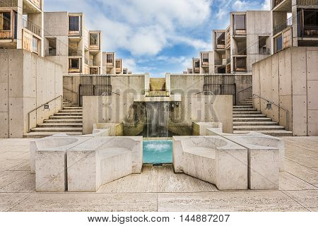 La Jolla, USA - December 10, 2015: Symmetrical architecture of the Salk Institute in San Diego with blue fountain pool
