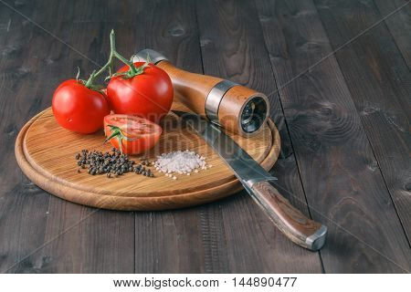 Fresh Grape Tomatoes And Coarse Salt For Use As Cooking Ingredients With A Halved Tomato