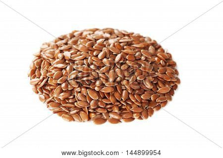 Closeup of flax seed or linseed isolated on white background.
