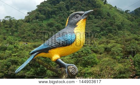 Cosanga, Napo / Ecuador - January 16 2016: Sculpture bird with yellow breast in the town of Cosanga