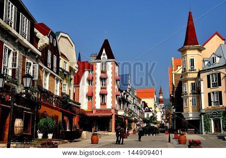 Bai Lu China - November 17 2013: View looking north on the principal street of the Sino-French village with its handsome Alsatian style buildings