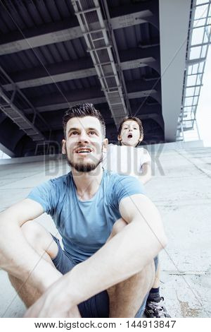 mature father with his son under the bridge having fun together happy family, lifestyle real people concept