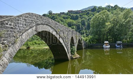 The old bridge in Rijeka Crnojevica Montenegro also known as Danilo's Bridge or Danilov Most was built across the Crnojevica River in 1853 to replace an earlier wooden bridge. The 43 metre limestrone bridge has a double arch.