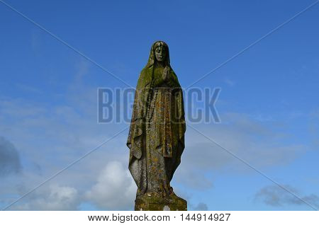 Stone statue of mother Mary in Ireland.
