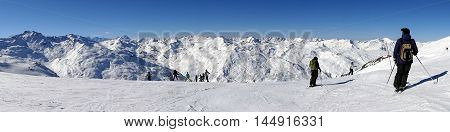 Alpine Ski In Snow Mountains Panoramic View