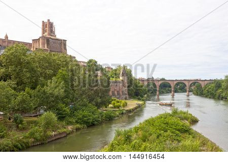 Tarn river Albi's cathedral Berbie palace and a boat in Albi France