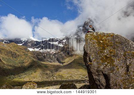 EL ALTAR ECUADOR - MARCH 08: Hiker unidentified walking around the crater of El Altar volcano taking a break on march 08 2015 El Altar Ecuador