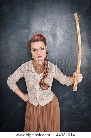 Angry Teacher With Stick