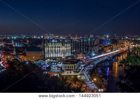 August 26, 2016: Ukraine, Kiev, Night. View of the Dnieper River and area Podol.