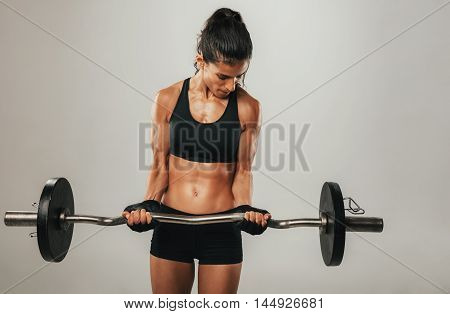 Strong Young Woman Lifting Barbell