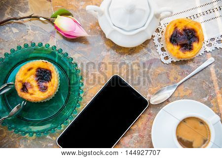 Conceived with the morning coffee and cakes (Pasteis de nata, typical pastry from Portugal) on natural marble surface.