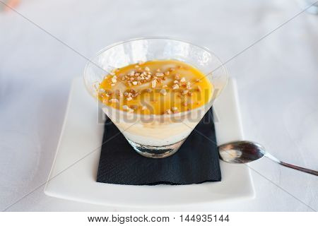 Custard And Almond In Elegant Glass With Spoon
