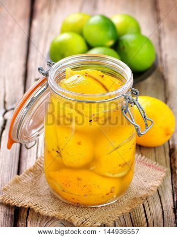 Preserved lemons with sea salt and spices. Moroccan cuisine. Vintage style.