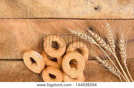 Taralli on the wood tableTraditional Italian snack from Puglia
