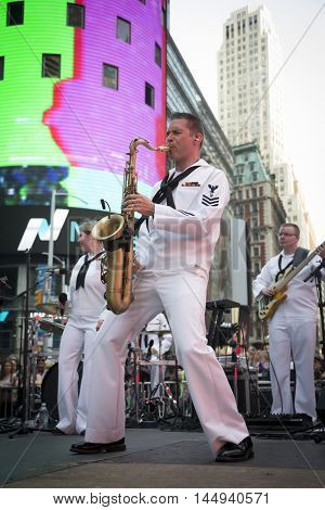 NEW YORK MAY 27 2016: Navy Band Northeast Rhode Island Sound perform a public concert on Military Island Pedestrian Plaza in Times Square during Fleet Week 2016 in Manhattan.